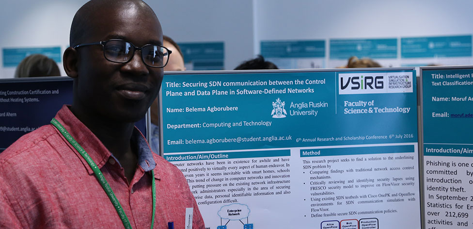 Belema Agborubere, PhD student, with his conference poster.