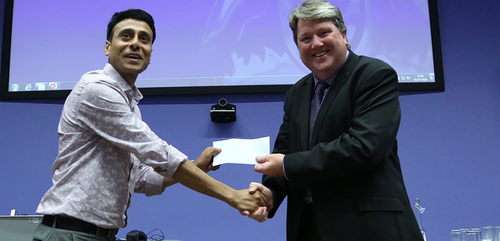 Ashim Chakraborty, PhD student, receives 1st prize from Prof Eamon Strain for his poster 'Mobile Based Decision Support System For Early Stage of Diabetic Retinopathy'.