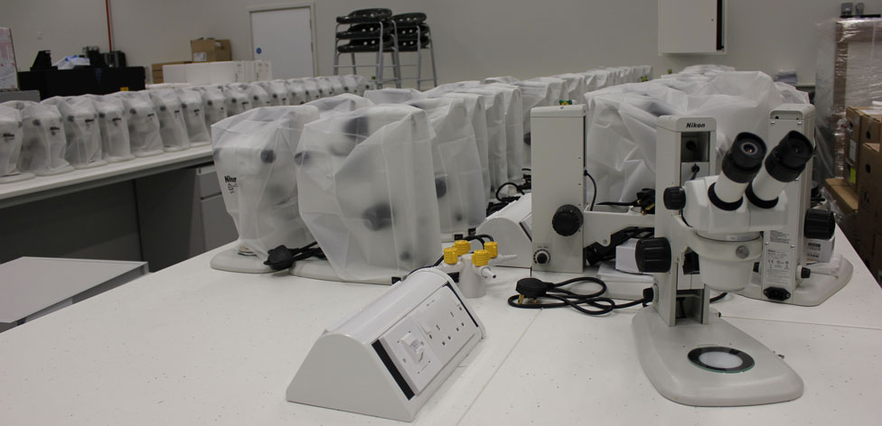 Microscopes waiting to be unpacked