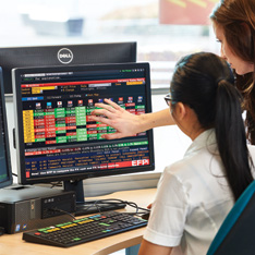 Two female students using the Bloomberg lab facilities on our Chelmsford campus