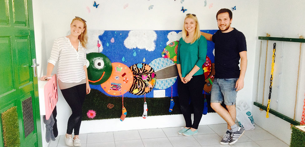 Our students with the caterpillar mural