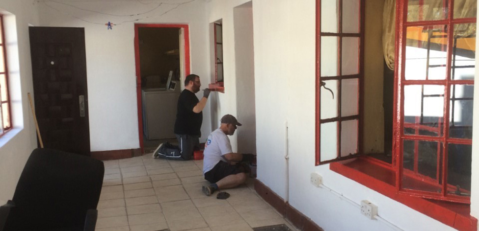 The team painting the window frames