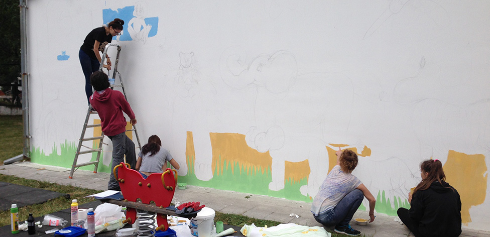 The team painting a mural