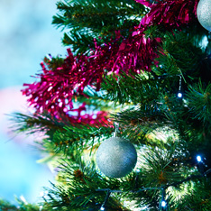 Image of Christmas tree with pink tinsel and blue baubles