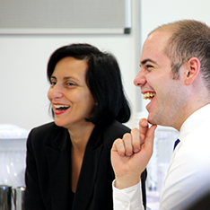 Businesswoman and businessman in a meeting, smiling