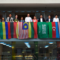 Students with flags at Anglia Ruskin
