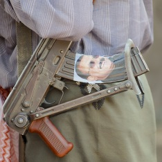 Photo of Ali Abdullah Saleh on a gun