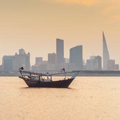 Bahrain Skyline with a boat on the river