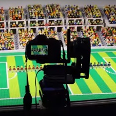 camera pointing at a football crowd scene made of lego