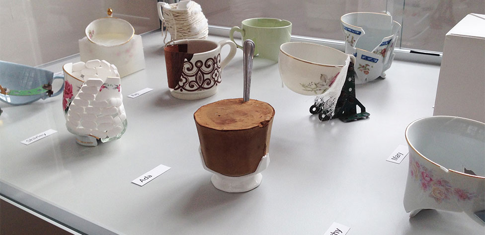 Detail from Frailty Installation. Using the breaking and mending of teacups as metaphors for individuals' experiences of frailty and ageing, the teacups are displayed with accompanying case studies.