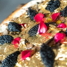 Gold pizza being sold by Industry Kitchen restaurant in New York