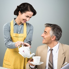 Housewife pouring the tea out for her husband