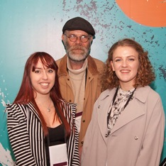 The artists Amber-Louise Wallis and Laura Burleigh standing with Chris Draper