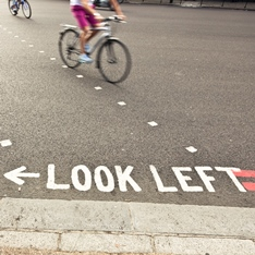 A 'look left' instruction on a road
