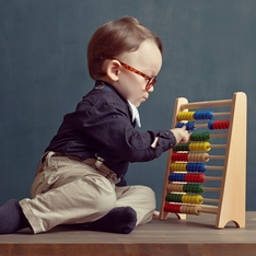 Child using an abacus