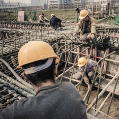 Migrant workers on a building site