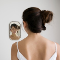 A young woman looking in the mirror