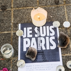Candles and a Je Suis Paris sign