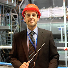 Man in a suit wearing a hard hat
