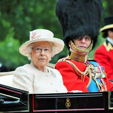 The Queen and Prince Philip in a horse-drawn carriage