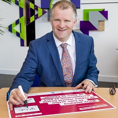 Professor Iain Martin signing the Time to Change pledge