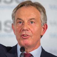 Tony Blair speaking into a microphone