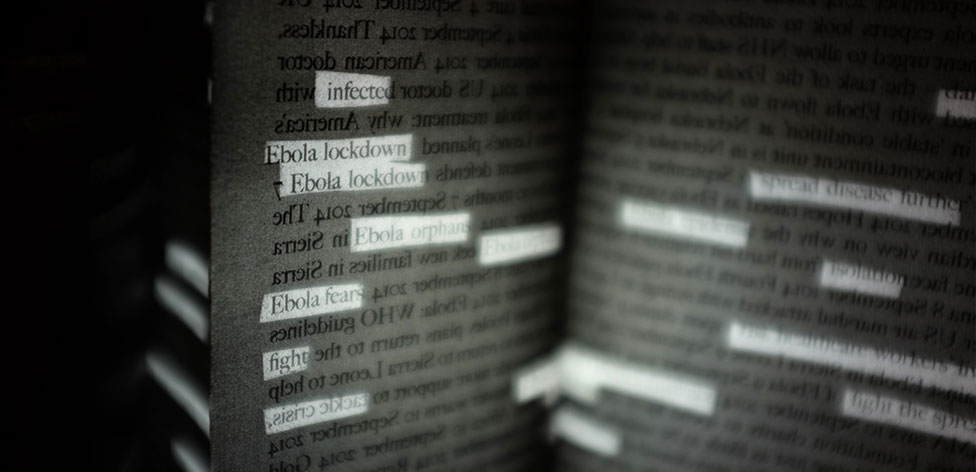 Detail from 'Ebola Headlines' Artist's Book. The reverse and obverse of text is coupled with light and dark to explore the use of language of newspaper headlines during the Ebola crisis.